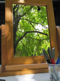 Preschool art - drawing on mirrors -ooh the possibilities if you do this outside the children could paint this tree and really focus on colours etc