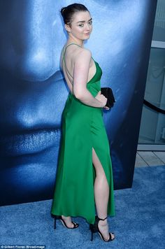 Green sight: The 20-year-old looked stunning in a silk backless gown, flashing her legs an...