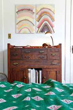 modern fabrics and art paired with vintage furniture- perfection. Good to know it's possible.