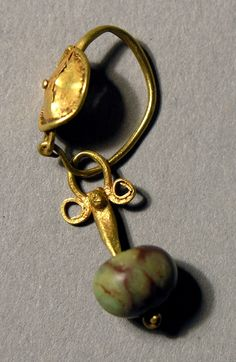 Earring Roman,        1st-3rd centuries C.E.      Gold, stone. I love this one, so pretty.