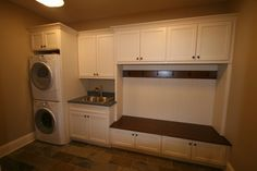 A mud room with a sink and washer/dryer. Throw all the dirty stuff in the washer before it gets tracked through the house. Of course, I want a regular laundry room too :)
