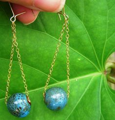 """Hand Made Blue & Brown Speckled Ceramic Sphere Bead is Suspended by a Delicate 18K Gold Chain. These are Perfect for Spicing up Any Outfit...or For a Special Night Out!    Dangle Length is Approximately 2""""  Blue Ceramic Bead is Approximately .5"""" Wide    18K Gold Earring Wires    Return to Shopping: www.etsy.com/...  FOR FREE SHIPPING COUPONS: www.facebook.com/......"""