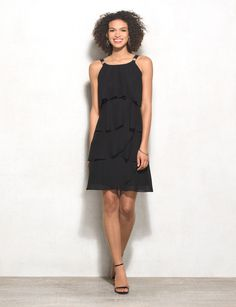 The dress silhouette with allover tiers that flatters your figure (and are so fun to dance in!). Wear this to your next event with your go-to heels and a sparkly statement bracelet! Imported.