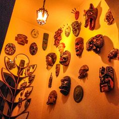 Entryway welcome mask layout. Various masks from, India, Mexico, Greece, Japan, Peru, Ecuador, Africa,
