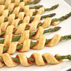 Prosciutto Asparagus Spirals   Tightly wrap 1 pastry strip around each asparagus spear, prosciutto-side in.  Place the pastries seam-side down onto 2 baking sheets.  Bake for 15 minutes or until the pastries are golden brown.