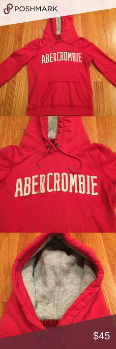 Red Abercrombie and Fitch pullover hoodie Front middle pocket. Hood is gray thermal. Great for cold weather. Excellent condition Abercrombie & Fitch Sweaters