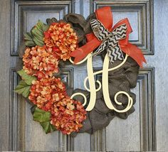 Great way to welcome fall! Brown burlap wreath with orange Hydrangeas and A yellow painted vine script monogram. This wreath has fo