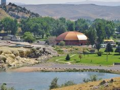 Visit the largest hot springs at Hot Springs State Park in Wyoming. This incredible park has it all: hot springs, bison, and a swinging bridge! Summer Cabins, Wyoming Vacation, Travel Oklahoma, Roadside Attractions, Weekends Away, Summer Travel, Thailand Travel, Hot Springs, Beach Resorts