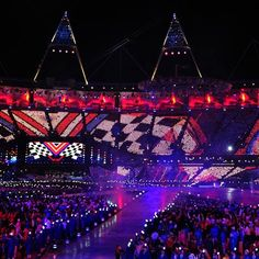 Animations on a 360 degree screen comprising 70,500 paddles held by the audience - boards of nine coloured LEDs by each seat in the stadium - seen Sept 6, 2012