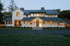 Great look for all buildings...home, barn, shed! Metal roof, white paint, dark windows