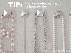 Great organizing idea ~ create a burlap cork board jewelry organizer and hang jewelry on nailheads!
