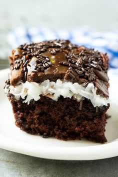 This chocolate coconut marshmallow cake features a rich chocolate cake layer topped with creamy coconut sauce and finished with chocolate frosting.