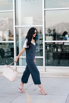 I don't know why I haven't jumped on the jumpsuit trend sooner (no pun intended ;) ) But guys! I love it! It is so comfortable but so easy + chic! I have worn this a couple times now and each time I paired a different top with it. You can dress is up, down, or in between. I went for the in between look! I love this basic white tee (that's on sale for $10 now). I've also worn it here. With this outfit I liked the shadows of the v-neck neckline complimenting each other I'm wearing...