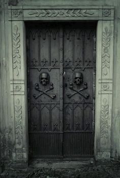 Halloween style!! Skulls on cemetery doors! Just perfect for here at 1313 Cemetery Hill!