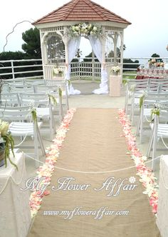 peach, pearls on chairs and gazebo, romantic feel with burlap runner Wedding aisle flower décor, wedding ceremony flowers, pew flowers, wedding flowers, add pic source on comment and we will update it. www.myfloweraffair.com can create this beautiful wedding flower look.