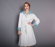 Vintage 1960s mod coat by Lilli Ann Knits. Made of a bright white polyester knit, fully lined with lightweight acetate.