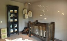 I actually like this birdcage/flying birds idea for my guest bedroom; though, it is cute in this woodsy boy's nursery.