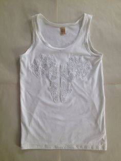 """This tank is inspired by my """"All White Collection"""". It's a simple soft and stretchy white tank top adorned with a beautiful appliqué. The appliqué is upcycled from a men's dress shirt and has an organic arabesque like design incorporating ornate stitching of silver threads.   This is a great tank for an """"All White Party"""", A pre-wedding tank for a groom getting married on a beach or whatever your imagination chooses."""