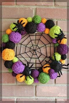 awesome-diy-halloween-wreaths-5, Foam balls, yarn and pipe cleaners. Maybe googly eyes for spiders. O yes, and a wire hanger for the shape.