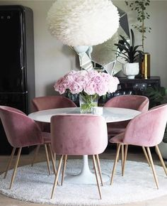 Wow! How gorgeous is this dining room with blush modern chairs?!!
