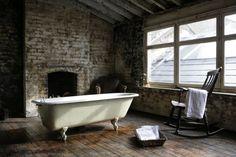stone fireplace   clawfoot tub   bathroom