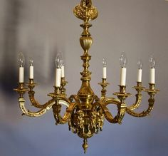 Superb quality 19th century Louis XIV style eight branch gilt metal chandelier