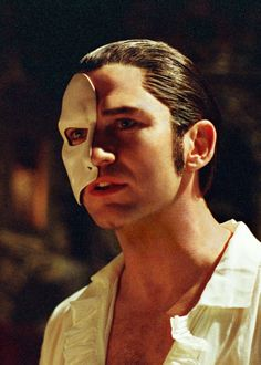 I would have run away with him instead of that wimpy count. Think again, Christine!  Still of Gerard Butler in The Phantom of the Opera