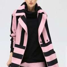 "HP/ Black & Pink Stripes Faux Wool Coat Amazingly Beautiful Pink and Black striped coat. Knee length, faux wool ( polyester and polycrylonitrile ) side pockets and mid section close snaps. Sizes M, L and XL. Measurements for M: length: 34"" Bust: 43"" Shoulder to shoulder: 17.5"" Sleeve Length: 27"" Size on hand L can ship immediately. Last picture is actual item. Cocobella Jackets & Coats"