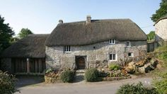 stone cottage with thatched roof. Gorgeous huge stones. the doorway looks very old. Stinhall.