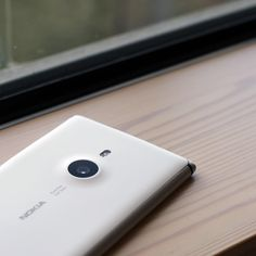 I actually think the lumia is a pretty good design. One can imagine how a case for this would extend the same parabolic curves around it. I think we still want our user to feel like they are using a lumia, nexus, etc. we just want them to feel like they are powering it in an amazing way, not using a REACH phone. People invest a lot in their devices so we shouldn't steal that ownership away by replacing the brand experience with our own.