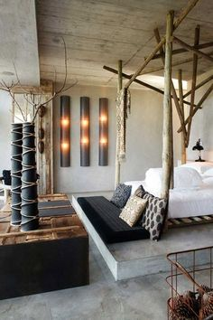 Natural bed frame resembling tree branches. An interesting room combination of modern and rustic elements.