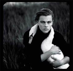 Leonardo dicaprio holding a goose.  This is really weird but also a blessing from the high heavens