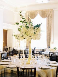 Hydrangea and greenery wedding centerpiece: http://www.stylemepretty.com/2016/11/03/modern-same-sex-wedding/ Photography: Lisa Ziesing for Abby Jiu - http://www.abbyjiu.com/