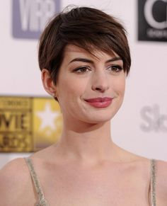 Short Hairstyles Lookbook: Anne Hathaway wearing Pixie (3 of 10). Anne styled her pixie into tousled side-swept bangs for the 2013 Critics' Choice Movie Awards.