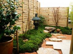 30 Magical Zen Gardens Love the lantern, but the fence is even better.  How to create a bamboo privacy fence?