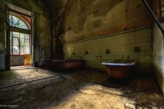 """Bathtubs - Baththubs in an abandoned psychiatry. This Thubs where used for so called Ice-Bath's """"Therapies"""". Terrible things happened within these walls."""