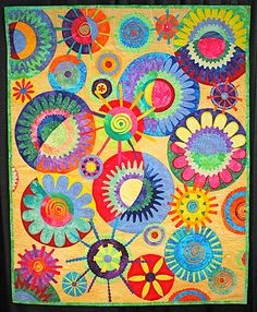 I love the whimsical circles and colors in this quilt by Pharr.  Cinda's circles by Karen Pharr by JonaG, via Flickr