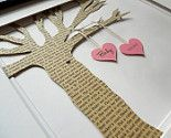 with the tree cut out of a page of a hymnal or an old Bible??? I could SO make this for the baby girl!!