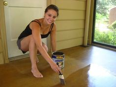 "This is a surprisingly easy task, so anyone with a garage, sunroom, basement or porch with a concrete floor should seriously consider this super simple process. Can use Behr Semi-Transparent Concrete Stain in ""Tuscan Gold"" from Home Depot to give unfinished looking concrete floors a warm wash of honey-gold color."
