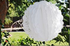 I'm posting ideas all over the place... but check out these balls made from lacey paper doilies.