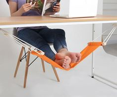 Kick back on casual Fridays while you toil away at endless TPS reports with the foot rest hammock at your desk. This small hammock attaches to each end of the desk and is completely adjustable to fully suit your lounging needs.