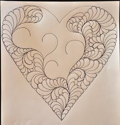 LuAnn Kessi: Feathered Heart.....Machine Quilting