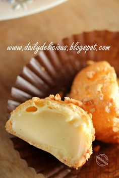 Almond-crusted choux buns, filled with cream, from Daily Delicious.