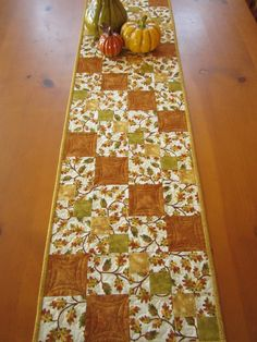 """It's time to decorate your table for Fall and this table runner would looking stunning. The main fabric has oak leaves with yellow, green and gold to complement the fabric. This table runner is 12"""" x"""