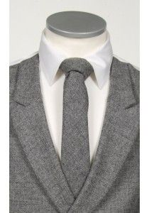An English tweed tie in a dark flannel grey fleck, an ideal wedding tie for the vintage Groom #vintagewedding #groom #tweed #tie #weddingtie #wedding #geekchic