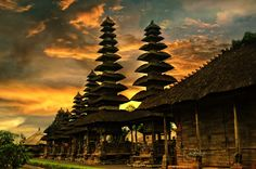 Pura Taman Ayun- Bali - Taman Ayun Temples are been build to look old, unpainted grassy walls makes the place more special, statues are crafted for authenticity, wood carving are the greatest highlight of the Balinese culture.The beautiful ganesha status, wooden flute with beautiful craving of shiva and vishnu