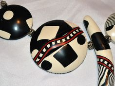 Black and white hollow polymer clay beads.