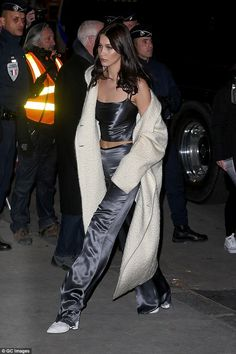 Every walk's a catwalk: Bella Hadid looked a little apprehensive as she left her hotel in Paris a day before her Victoria's Secret catwalk show debut