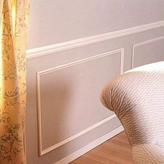 Simple molding rectangles to give some interest to the lower portion of the room instead of using a different color.