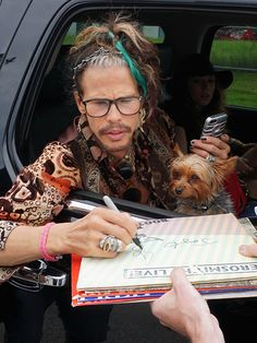Stars and Their Pets   STEVEN TYLER   How much is that doggy in the window? The singer and his tiny terrier pause (ahem, paws) to sign autographs for eager fans on Saturday in Boston, Massachusetts.